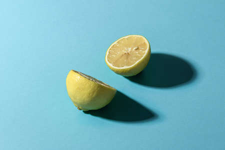 Sliced lemon on a blue background. Conceptual minimalism.