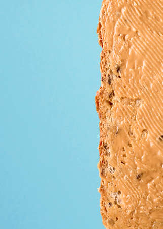 Walnut butter sandwich on a blue background with copies of space.