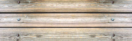 Texture of a wooden background with rivets. Wooden background.