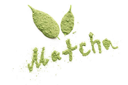 Matcha tea powder in the form of an inscription on a white background. Top view.