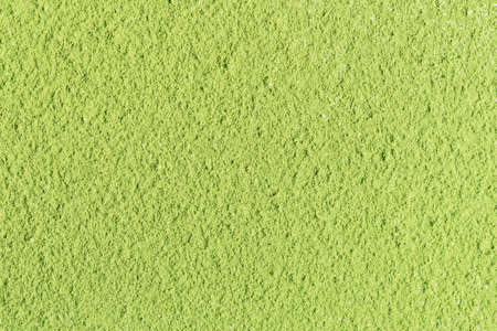 The texture of green matcha tea powder. Top view.