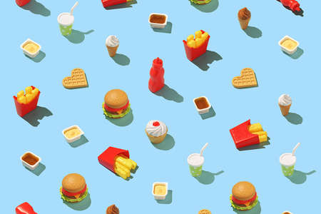 Creative fast food concept. Seamless fast food pattern on a bright blue background. Stock Photo