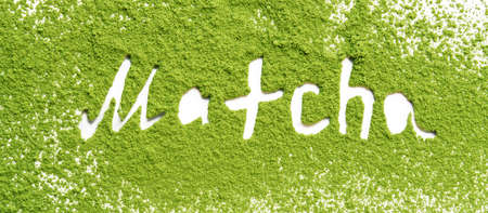 Green matcha tea powder with lettering on a white background.