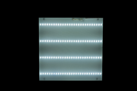 ceiling square lamp with fluorescent lamps on black isolated background