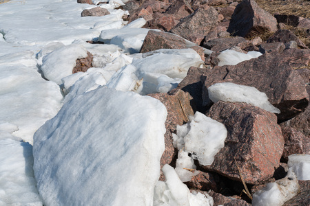 beautiful broken ice background and granite stone top view. the texture of the ice and rock Imagens