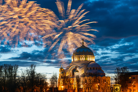 fireworks in the sky above the dome of St. Nicholas Cathedral in Kronstadt, St. Petersburg. cityscape