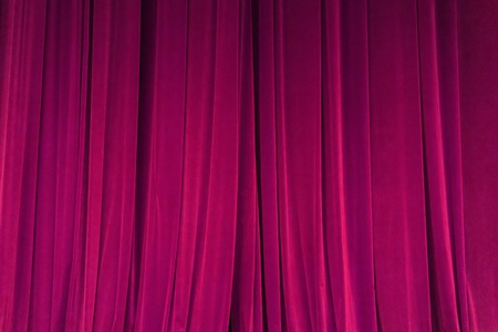 closed red curtain background spotlight beam illuminated. Theatrical drapes. Wallpaper design Stock fotó