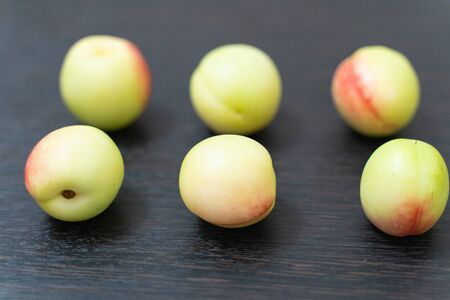 fresh ripe apricots on a dark wooden table close-up. fruit and food