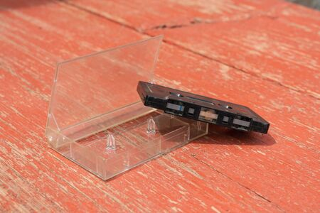 old film audio cassette on a wooden table