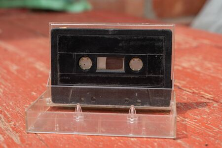 old film audio cassette on a wooden table Banque d'images