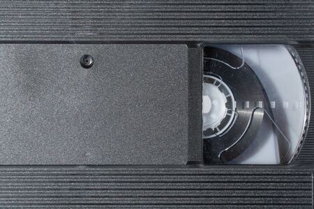 Old black VHS video tape cassette close-up as background Stock Photo
