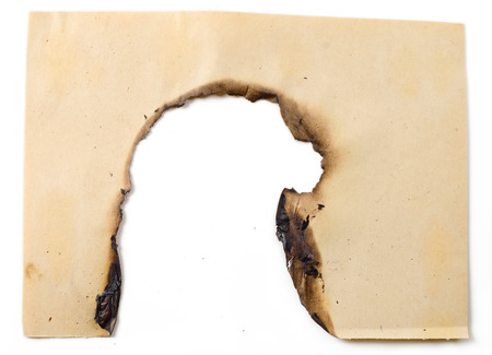 burned paper: the sheet of old burned paper on the isolated white background