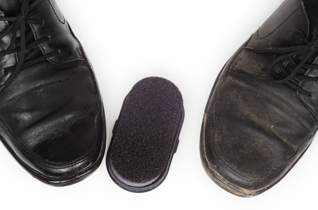 outsole: two black mens Shoe, one treated with Shoe Polish, and the other dirty
