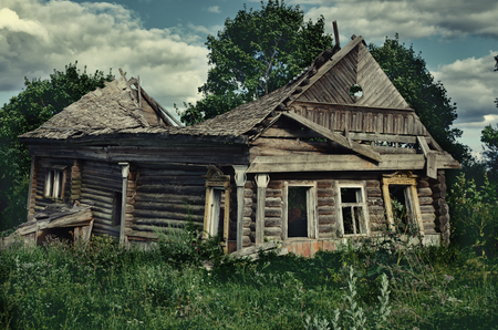 disrepair: An old dilapidated wooden house. Shot in the Yaroslavl region, Russia.