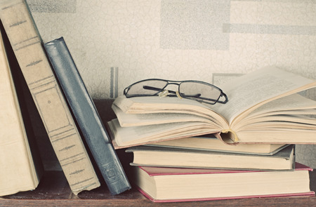 information age: old books lay on a background of light gray walls