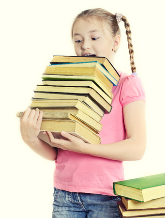 heaviness: Ten-year girl with a bewildered expression holds a lot of books.