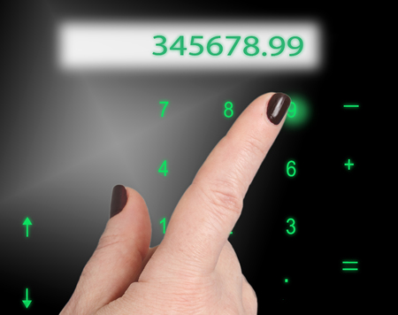 interactivity: Female finger presses the greenish numbers on the keyboard. Just above the display with numbers. Stock Photo