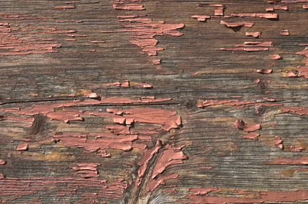 remnants: the surface of old wood with remnants of brown paint Stock Photo