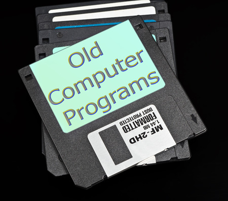 megabytes: old floppy disk with a capacity of 1.4 megabytes on a black background. Upper inscription: Old computer programs