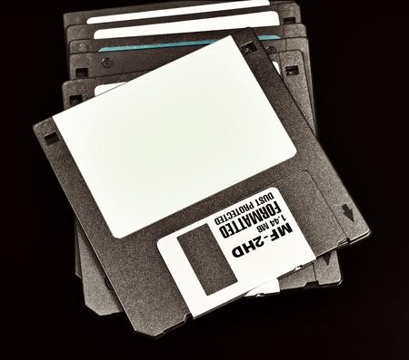 megabytes: old floppy disk with a capacity of 1.4 megabytes on a black background.