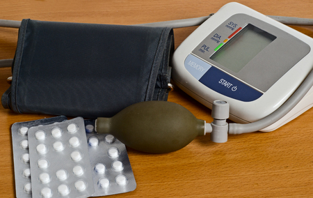 stress testing: apparatus for measurement of blood pressure rests on a wooden surface