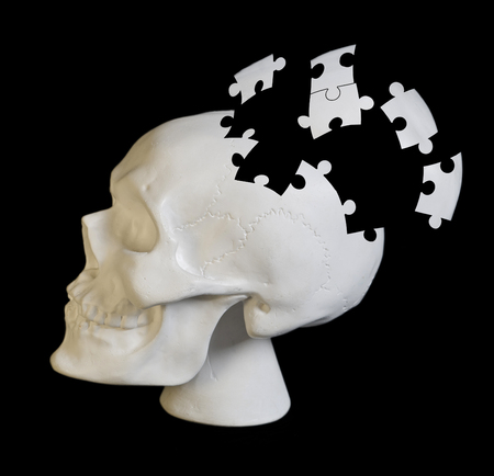 image of a human skull with puzzle elements. Conceptually shows the hard work of the brain, brainstorming  Stock Photo