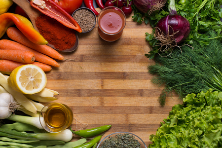 directly above: Photo from directly above of variation of different autumn vegetables and spices on wooden background