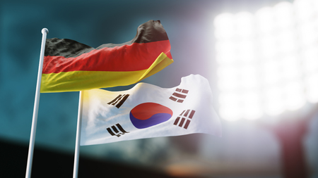 3D Illustration. Two national flags waving on wind. Night stadium. Championship 2018. Soccer. Germany versus South Korea Banco de Imagens