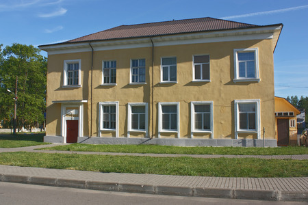 two floors: administrative building with two floors with yellow walls. Nevskaya Dubrovka, Leningrad region, Russia Editorial
