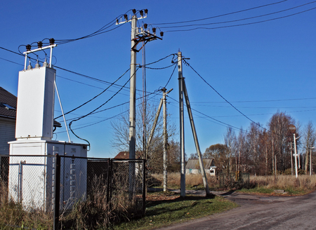 electric transformer and power lineby the road in the village in the remote area