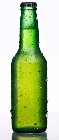 alcohol bottles: Green beer bottle, with condensation drops