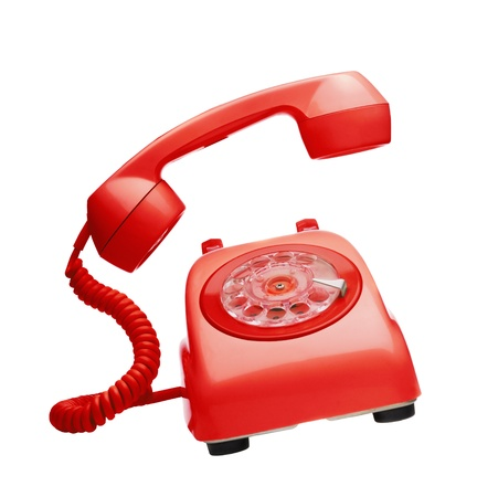 rotary dial telephone: Red vintage telephone ringing