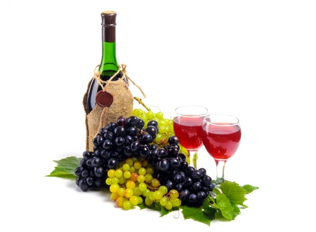 Arrangement of grapes with a bottle of wine and glasses photo