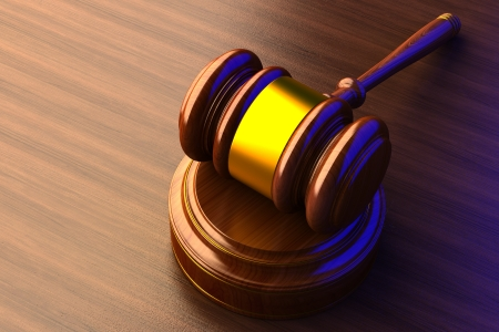court proceedings: judges gavel a wooden background