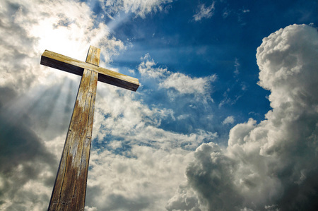 Cross against the sky. Happy Easter. Christian symbol Stock Photo