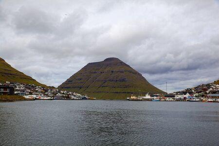 The island of Kunoy on a cloudy day, view fromf Klaksvik, Faroe Islands, Denmark. Long exposure.