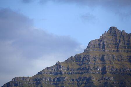 Green grass pyramid mountain of Kalsoy, Faroe Islands