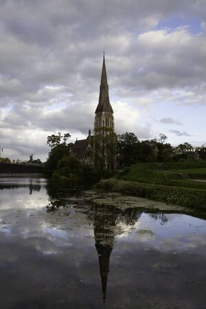 St. Alban's Church reflected in the water at susnet