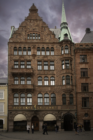 MALMO, SWEDEN - 13 September 2019: The city's oldest pharmacy Apoteket Lejonet on City Hall Square, well-known for its vintage Art Noveau interior at sunset Archivio Fotografico - 136348811