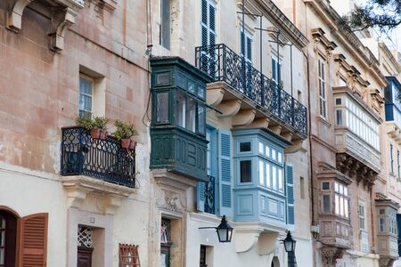 Valletta, Malta - 5 January 2020: Typical Maltese blinds and balconies