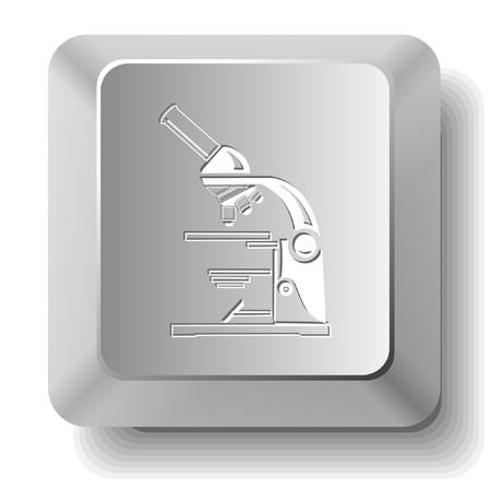 研究室の顕微鏡。コンピューターのキー。