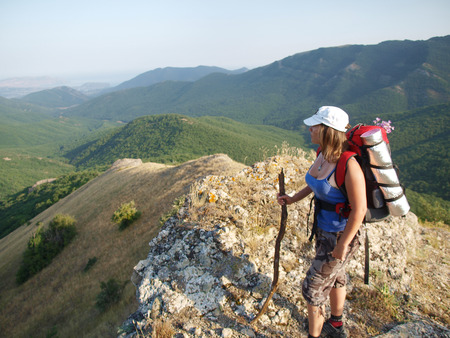 eminence: The magnificent landscape opens to a woman who stands on the top of the mountain  Stock Photo
