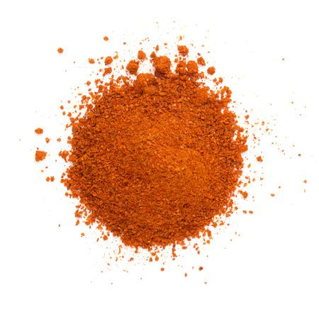 Heap ground paprika isolated on white background photo