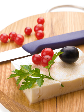 feta cheese and cranberries on wooden cutting board photo