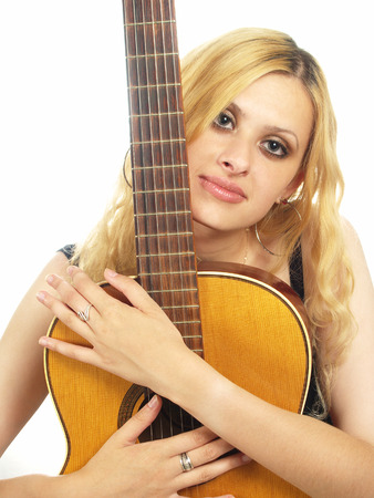 closeup portrait of young woman with guitar photo