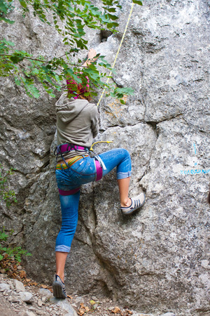 Young female rock climber photo