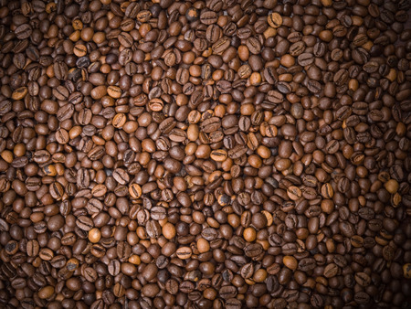 invigorate: Numerous coffee beans which have been scattered all over the surface