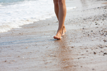 woman walking on the sand beach photo