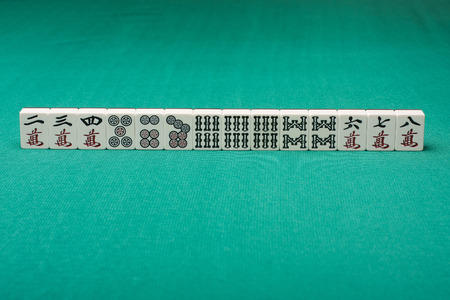 table surface: Smooth table surface with mahjong on it