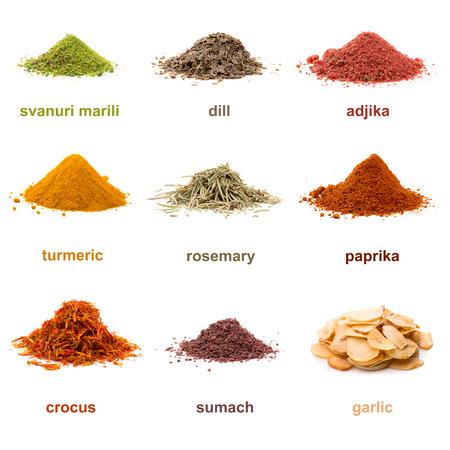 dill seed: Heap ground Svanuri marili, dill seed, adjika, turmeric, rosemary, paprika, saffron, sumach and garlic isolated on white background